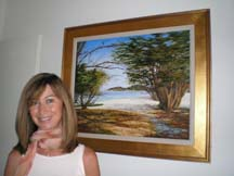 Photo of Marie Christine Briot-Connolly beside one of her paintings