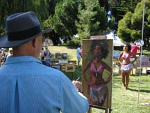 Portrait artist Christopher Newhard painting a model by Anglea Young