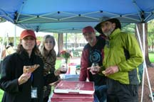 Plein Air artists eating pizza in the rain by Angela Young